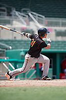 GCL Orioles catcher Jose Montanez (31) follows through on a swing during a game against the GCL Red Sox on August 9, 2018 at JetBlue Park in Fort Myers, Florida.  GCL Red Sox defeated GCL Orioles 10-4.  (Mike Janes/Four Seam Images)