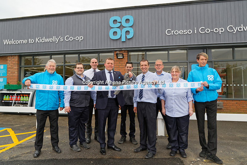 L-R Brian George from the events team, Dan Pritchard, area manager Ed Howe, Local Councilor Andrew Jenkins, Aaron Parker, store manager Anthony Thorne, Mark Jones, Dawn Higginson-Thomas and Jonathan Hawkins of the events team
