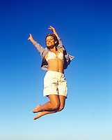 Young woman jumping in the air.