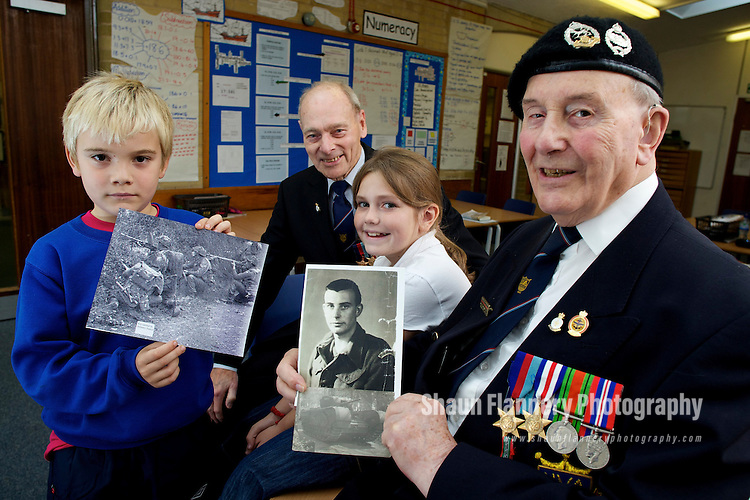 Pix: Shaun Flannery/shaunflanneryphotography.com...COPYRIGHT PICTURE>>SHAUN FLANNERY>01302-570814>>07778315553>>..30th September 2010..........Sheffield war veterans visit Concord Junior School to 'Keep the Memories Alive'.The World War 2 'heroes' gave a talk to year 4 &5 pupils about their experiences during the war..Veterans Don Walker (in beret) and Gordon Drabble speak to Daniel Wells and Hope Jessop.