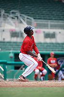 GCL Red Sox shortstop Jecorrah Arnold (17) follows through on a swing during a game against the GCL Rays on August 1, 2018 at JetBlue Park in Fort Myers, Florida.  GCL Red Sox defeated GCL Rays 5-1 in a rain shortened game.  (Mike Janes/Four Seam Images)