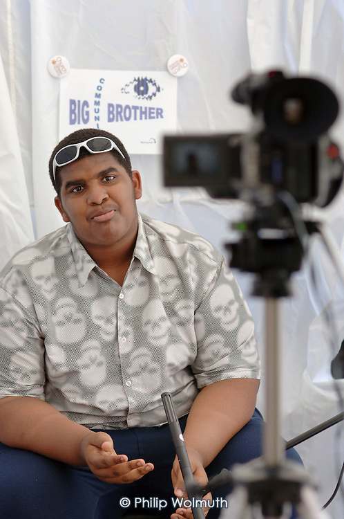 A local resident is interviewed as part of a local consultation exercise during Church Street Summer Festival 2005, Paddington, London.