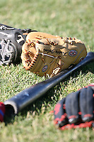 June 24th 2007:  A bat and gloves sit in the grass before a game at Jerry Uht Park in Eria, PA.  Photo by Mike Janes/Four Seam Images