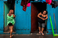Salvadoran sex worker stand in front of the rooms where their sexual services are offered to clients in San Salvador, El Salvador, 12 April 2018. Although prostitution is not legal in El Salvador, dozens of street sex workers, wearing provocative miniskirts, hang out in the dirty streets close to the capital's historic center. Sex workers of all ages are seen on the streets but a significant part of them are single mothers abandoned by their male partners. Due to the absence of state social programs, they often seek solutions to their economic problems in sex work. The environment of street sex business is strongly competitive and dangerous, closely tied to the criminal networks (street gangs) that demand extortion payments. Therefore, sex workers employ any tool at their disposal to struggle hard, either with their fellow workers, with violent clients or with gang members who operate in the harsh world of street prostitution.