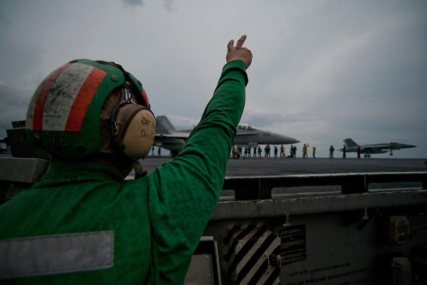 120416-N-DR144-669 INDIAN OCEAN (April 16, 2012) A deck edge catapult operator assigned to the Air Department's V-2 Division signals while launching aircraft from the flight deck of the Nimitz-class aircraft carrier USS Carl Vinson (CVN 70). Carl Vinson and Carrier Air Wing (CVW) 17 are deployed participating in the Malabar Exercise with ships and aircraft from the Indian Navy. (U.S. Navy photo by Mass Communication Specialist 2nd Class James R. Evans/Released)