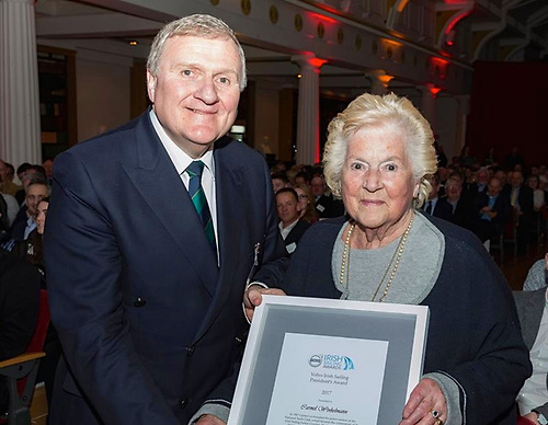 Irish Sailing President Jack Roy presenting Carmel Winkelmann with the President's Award for 2017, one of many tokens of appreciation she received in a long life of cheerful and effective service to sailing