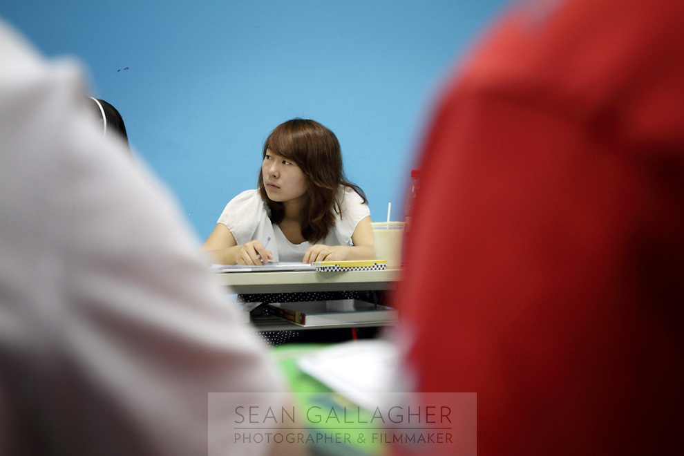 CHINA. Beijing.A student during class at Aoji, an organisation which assists Chinese students in language training and placing them in overseas universities throughout the world. 2010