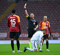 15th March 2020, Istanbul, Turkey;   Referee Abdulkadir Bitigen show a yellow card to Ryan Donk of Galatasaray during the Turkish Super league football match between Galatasaray and Besiktas at Turk Telkom Stadium in Istanbul , Turkey on March 15 , 2020.