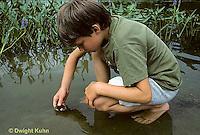 FA27-093z  Boy releasing frog at pond