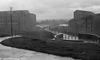 Driving rain sweeps through the housing scheme, Wester Hailes, Scotland, 1979.  John Walmsley was Photographer in Residence at the Education Centre for three weeks in 1979.  The Education Centre was, at the time, Scotland's largest purpose built community High School open all day every day for all ages from primary to adults.  The town of Wester Hailes, a few miles to the south west of Edinburgh, was built in the early 1970s mostly of blocks of flats and high rises.