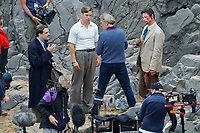 Pictured: Will Poulter and Hugh Laurie. Friday 18 June 2021<br /> Re: Film set with a scene being filmed with Hugh Laurie as a director at Three Cliffs Bay in the Gower Peninsula, Wales, UK.