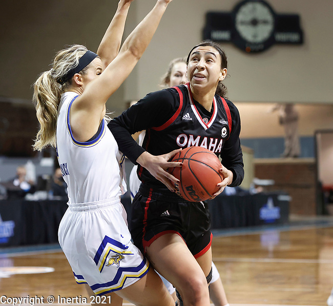 SIOUX FALLS, SD - MARCH 6: Josie Filer #25 of the Omaha Mavericks makes a move against Lindsey Theuninck #3 of the South Dakota State Jackrabbits during the Summit League Basketball Tournament at the Sanford Pentagon in Sioux Falls, SD. (Photo by Richard Carlson/Inertia)