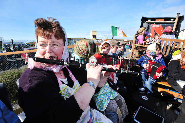 Breda O' Donoghue and her pupils entertain the crowds at the St Patrick's Day parade in Miltown. Photograph by Declan Monaghan