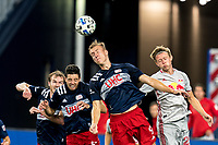 FOXBOROUGH, MA - AUGUST 29: Adam Buksa #9 of New England Revolution defensive head ball on a corner kick during a game between New York Red Bulls and New England Revolution at Gillette Stadium on August 29, 2020 in Foxborough, Massachusetts.