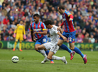 Pictured: Jack Cork of Swansea (C) is brought down by Fraizer Campbell (L) and Jordon Mutch (R) of Crystal Palace<br /> Re: Premier League match between Crystal Palace and Swansea City at Selhurst Park on May 24, 2015 in London, England, UK
