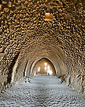 On entering Karak Castle the visitor's path leads through a massive and light-filled central hall.  Karak stands at the top of a massive promontory near the Dead Sea in Jordan.  It was built at the extreme end of their domain by the crusaders of the Kingdom of Jerusalem.  © Rick Collier