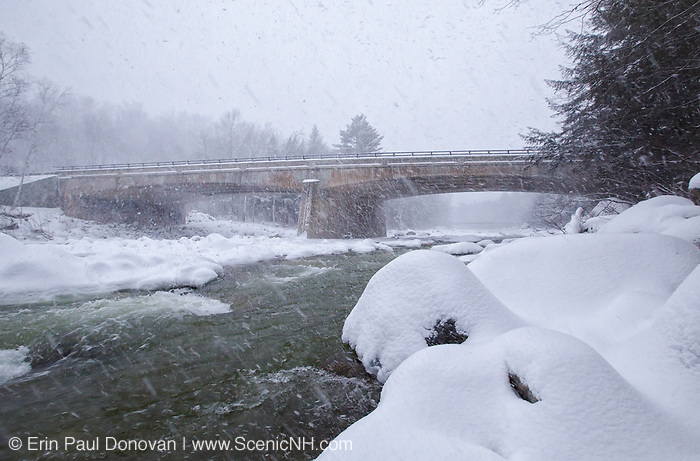 Route 112 (Kancamagus Scenic Byway) bridge during a winter snow storm. This bridge crosses the East Branch of the Pemigewasset River in Lincoln, New Hampshire USA.