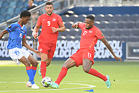 KANSAS CITY, KS - JULY 15: Dutherson Clervaux #15 of Haiti ,Cyle Larin #17 of Canada during a game between Canada and Haiti at Children's Mercy Park on July 15, 2021 in Kansas City, Kansas.