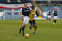 20th February 2021; Dens Park, Dundee, Scotland; Scottish Championship Football, Dundee FC versus Queen of the South; Cammy Kerr of Dundee takes on Isaiah Jones of Queen of the South