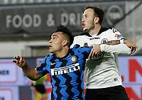 Lautaro Martinez of Inter  and Ardian Ismajli during the  italian serie a soccer match,Spezia Inter Milan at  the STadio Picco in La Spezia Italy ,