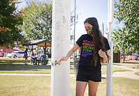 """Ava Moore of Springdalewalks through a coming out door, Sunday, October 11, 2020 at Dave Peel Park in Bentonville. PFLAG of Northwest Arkansas hosted a National Coming Out Day multi-stop event. Participants gathered at the park for a celebration, which included a free lunch and picture taking opportunities with the National Coming Out Day door that people could sign and come out of. In addition, registered participants visited several LGBTQIA friendly  partner businesses for a day of shopping and freebies. """"People are struggling with the lack of in-person interaction,"""" said Catie Hartling president of PFLAG. """"We're trying to find a way for people to celebrate and interact and at a safe distance and celebrate publicly because pride didn't happen in person this year."""" Check out nwaonline.com/2010012Daily/ for today's photo gallery. <br /> (NWA Democrat-Gazette/Charlie Kaijo)"""