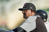 Kannapolis Intimidators pitching coach Jose Bautista (38) watches from the dugout during the game against the Hickory Crawdads at Kannapolis Intimidators Stadium on May 6, 2019 in Kannapolis, North Carolina. The Crawdads defeated the Intimidators 2-1 in game one of a double-header. (Brian Westerholt/Four Seam Images)