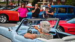 TORRINGTON, CT 073021JS17 Sandy Jones, Lee Marcella, left,  along with Janet Iffland and Wayne Iffland look on as a classic car drives past during the Main Street Cruise Friday in downtown Torrington. The car show and carnival benefits Torrington PAL and the police department's Explorers program.  This was the first downtown car show since 2019. <br />  Jim Shannon Republican American