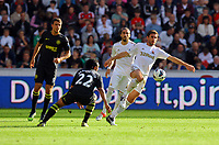 Saturday, 20 October 2012<br /> Pictured: Angel Rangel of Swansea (R) against Jean Beausejour (22) of Wigan<br /> Re: Barclays Premier League, Swansea City FC v Wigan Athletic at the Liberty Stadium, south Wales.