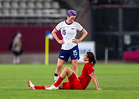 KASHIMA, JAPAN - AUGUST 2: Megan Rapinoe #15 of the USWNT and Christine Sinclair #12 of Canada talk after the game between Canada and USWNT at Kashima Soccer Stadium on August 2, 2021 in Kashima, Japan.