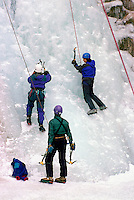 Female Ice Climbers learning to climb on Frozen Waterfall at Ice Climbing Clinic, Marble Canyon Provincial Park, Southwestern British Columbia, Canada