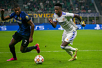 Milan, Italy - september 15 2021 - vinicius junior and dumfries in action during Inter- Real Madrid champions league