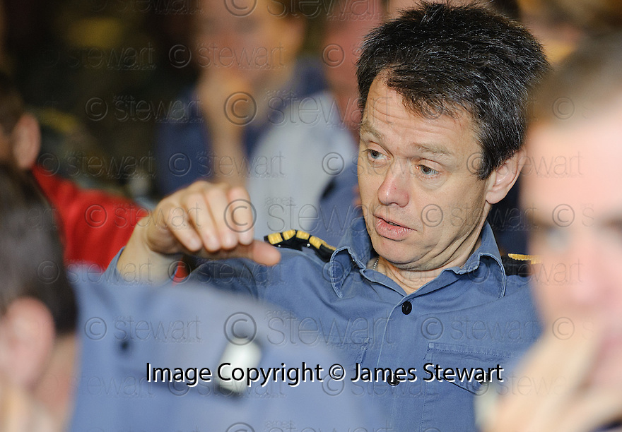 CAPTAIN ALEX BURTON SHOWS HIS FRUSTRATION AS HE WATCHES THE RUGBY WORLD CUP QUARTER FINAL BETWEEN FRANCE AND ENGLAND ON THE HMS BULWARK WHILST ON A BREAK FROM A JOINT EXERCISE IN LOCH EWE AND OFF THE SCOTTISH ATLANTIC COAST