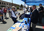 Bill Quenga, with Silver State Industries, sells collectible items during the decommissioning ceremony at the historic Nevada State Prison in Carson City, Nev. on Friday, May 18, 2012. .Photo by Cathleen Allison