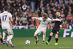 Luka Modric of Real Madrid fights for the ball with Dries Mertens of SSC Napoli during the match Real Madrid vs Napoli, part of the 2016-17 UEFA Champions League Round of 16 at the Santiago Bernabeu Stadium on 15 February 2017 in Madrid, Spain. Photo by Diego Gonzalez Souto / Power Sport Images