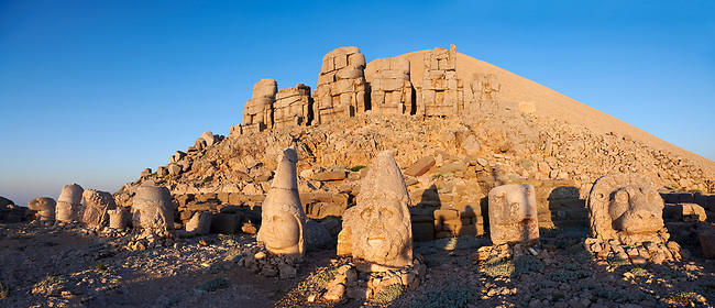 Statue heads, from right,  Lion, Eagle, Herekles, Apollo, Zeus, Commagene, Antiochus, & Eagle, with headless seated statues in front of the stone pyramid 62 BC Royal Tomb of King Antiochus I Theos of Commagene, east Terrace, Mount Nemrut or Nemrud Dagi summit, near Adıyaman, Turkey