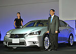 November 30, 2011, Tokyo, Japan - Akio Toyoda, president of Toyota Motor Corp. presents Lexus GS450h during a press preview of the Tokyo Motor Show on Wednesday, November 30, 2011. ..The Tokyo Motor Show opened to the press Wednesday as Japanese automakers unveiled a bevy of electric cars and other green vehicles at a much smaller venue in central Tokyo, to which the show moved from the nations largest exhibition hall in neighboring Chiba prefecture after 24 years. A total of 176 brands from 13 countries and regions participated in the show. The number of foreign automakers has increased to 24 from previous nine. Out of 398 models, 52 will be shown for the very first time. An estimated 800,000 visitors are expected to attend the week-long exhibition, compared with 1.5 million in 2005, according to the organizers.(Photo by Natsuki Sakai/AFLO) [3615] -mis-..