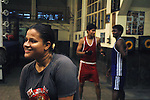 INDIA (West Bengal - Calcutta)July 2007,Shakila Babe after practice at Sports Authority of India Complex (East Zone) in Kolkata. Shakila and Shanno are twins from a poor muslim family of Iqbalpur, Kolkata. . Inspite of their late father's unwillingness to send his daughters to take up  boxing her mother Banno Begum inspired them to take up boxing at the age of 3. Their father was more concerned about the social stigma they have in their community regarding women coming into sports or doing anything which may show disrespect to the religious emotions of his community. Shakila now has been recognised as one of the best young woman boxers of the country after she won the  international championship at Turkey in the junior category. Shanno is also been called for the National camp this year. Presently Shakila and shanno has become the role model in the Iqbalpur area  and parents from muslim community of Iqbalpur have started showing interst in boxing. Iqbalpur is a poor muslim dominated area mostly covered with shanty town with all odds which comes along with poverty and lack of education. - Arindam Mukherjee