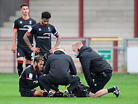 Lincoln City's Jorge Grant receives treatment for an injury from Lincoln City's head of sports science and medicine Mike Hine, centre, and Lincoln City sports science and medicine assistant Luke Treadwell<br /> <br /> Photographer Chris Vaughan/CameraSport<br /> <br /> The EFL Sky Bet League One - Fleetwood Town v Lincoln City - Saturday 17th October 2020 - Highbury Stadium - Fleetwood<br /> <br /> World Copyright © 2020 CameraSport. All rights reserved. 43 Linden Ave. Countesthorpe. Leicester. England. LE8 5PG - Tel: +44 (0) 116 277 4147 - admin@camerasport.com - www.camerasport.com