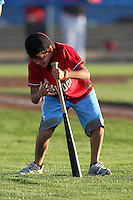 Batavia Muckdogs on field promotion (bat spin) during a game vs. the Williamsport Crosscutters at Dwyer Stadium in Batavia, New York July 26, 2010.   Batavia defeated Williamsport 3-2.  Photo By Mike Janes/Four Seam Images
