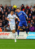 Saturday, 03 November 2012<br /> Pictured L-R: Garry Monk of Swansea is battling for a header against Fernando Torres of Chelsea<br /> Re: Barclays Premier League, Swansea City FC v Chelsea at the Liberty Stadium, south Wales.