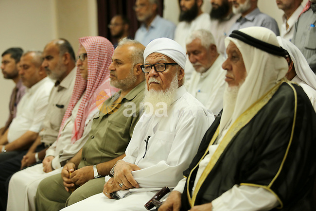 Members of Palestine Scholars Association attend a press conference to show solidarity with Palestinians in Jerusalem, in Gaza city on July 30, 2017. Photo by Ashraf Amra