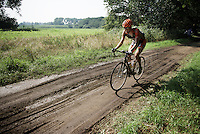 Cyclocross-rider Tim Merlier (BEL/VastgoedService-Golden Palace) on his way to a podium (over the mud)<br /> <br /> 90th Schaal Sels 2015