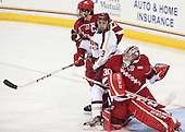 Frankie Simonelli (Wisconsin - 27), Johnny Gaudreau (BC - 13), Landon Peterson (Wisconsin - 30) - The Boston College Eagles defeated the visiting University of Wisconsin Badgers 9-2 on Friday, October 18, 2013, at Kelley Rink in Conte Forum in Chestnut Hill, Massachusetts.
