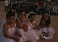 """Young brides in the celebration organized by the Hamas movement, a collective marriage 110 bridegroom and the bride in the town of Beit Lahia in the northern Gaza Strip, August 2, 2007 .""""photo by fady Adwan"""""""