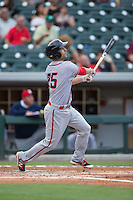 Scott Sizemore (25) of the Syracuse Chiefs follows through on his swing against the Charlotte Knights at BB&T BallPark on June 1, 2016 in Charlotte, North Carolina.  The Knights defeated the Chiefs 5-3.  (Brian Westerholt/Four Seam Images)