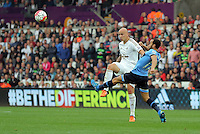 (L-R) Jonjo Shelvey of Swansea crosses the ball past Andros Townsend of Tottenham Hotspur during the Barclays Premier League match between Swansea City and Tottenham Hotspur played at The Liberty Stadium, Swansea on October 4th 2015