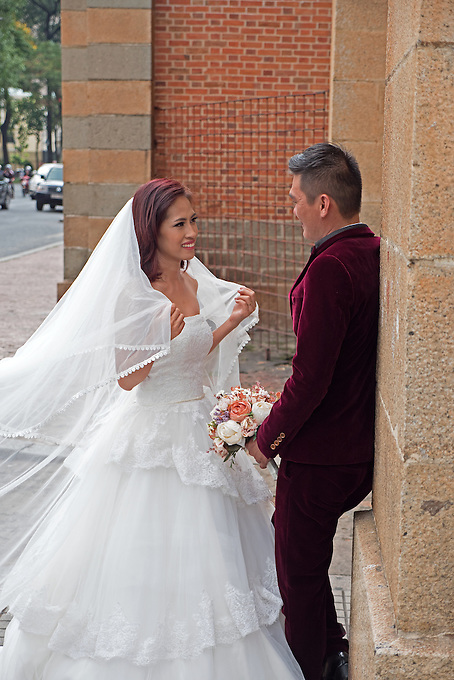 Getting married, Street Life in Saigon or in Vietnamese Ho Chi Minh City where old and new architecture mix in harmony. The bustling Metropolis of South Vietnam.