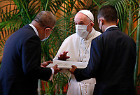 """Pope Francis presents a joint declaration signed by religious leaders to Alok Sharma, president of the 2021 U.N. Climate Change Conference, and Luigi Di Maio, Italian foreign minister, during the meeting, """"Faith and Science: Towards COP26,"""" with religious leaders in the Hall of Benedictions at the Vatican Oct. 4, 2021. The meeting was part of the run-up to the U.N. Climate Change Conference, called COP26, in Glasgow, Scotland, Oct. 31 to Nov. 12, 2021."""