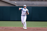 CHAPEL HILL, NC - FEBRUARY 27: Danny Serretti #1 of North Carolina throws the ball to first base during a game between Virginia and North Carolina at Boshamer Stadium on February 27, 2021 in Chapel Hill, North Carolina.