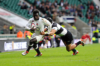 Christian Wade of England goes round Yoshi Fujita of Barbarians to score his hat trick during the match between England and Barbarians at Twickenham Stadium on Sunday 31st May 2015 (Photo by Rob Munro)